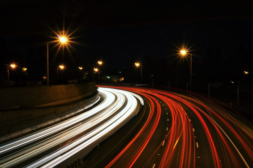time-lapse photography of highway road at night